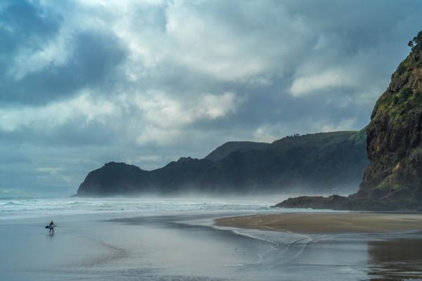 Surfer-on-Piha-beach
